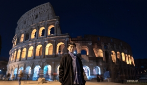 Exploring Rome by moonlight, dancer Kim Jisung takes a moment to pose in front of the Colosseum.