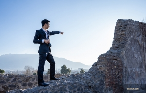 Dancer Eric Lam points the way in Pompeii.
