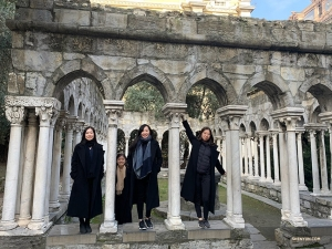 From left, Chelsea Xian, Yarou Liao, Crystal Ho, and Jenny He stand between cloisters that remain from a 12th century convent in Genoa, Italy. (Photo by Han Ye)