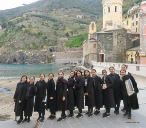 Ladies line up on the shore of Manarola, where an old church bell tower was used to warn of potential pirate raids back in the day. (Photo by dancer Diana Teng)