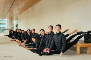 Meanwhile, Shen Yun World Company Dancers warm up in the lobby of the Overture Center for the Arts in Madison, Wisconsin. (Photo by Regina Dong)