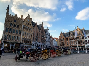 Next, they check out the Markt of Bruges, a vibrant plaza in the heart of the city.