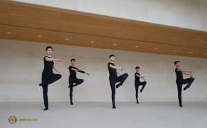 In the open space of Overture Hall, dancer Ben Chen captures photos of the dancers during daytime training.