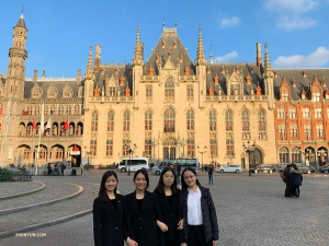 While in Belgium, violinists Yarou Liao, Kristy Kou, Jenny He, and Julia Zhu visit Burg Square, one of the main squares in Bruges.