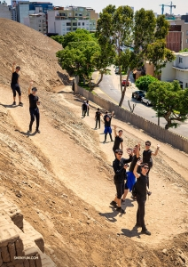 The group heads back to regular city buildings after exploring the pyramid located right in the middle of Lima.