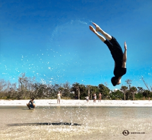 Dancer Jackie Pun cools off by flipping in the water. (Photo by Alvin Song)