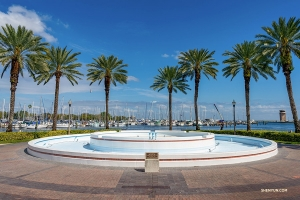 The theater's fountains (much more impressive when running) are surrounded by palm trees and a view of the bay. (Photo by Tony Xue)