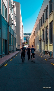 Dancers explore downtown Auckland on foot.