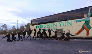 Shen Yun performers arrive in Jacksonville, Florida and quickly assemble into a welcoming pose in front of their tour bus.