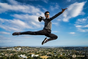 A superhero-dancer soars over Auckland. (Photo by Tony Xue)
