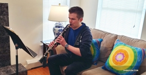 Clarinet player Yevgeniy Reznik practicing some of his solos from previous Shen Yun Symphony Orchestra concert tours. Also, notice his product placement with not one, but two cushion covers from Shen Yun Shop!