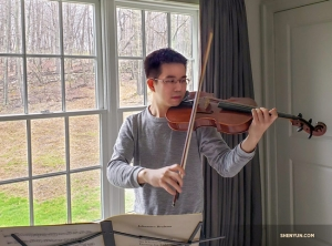 Violist James Hwang is practicing a Brahms viola sonata.
